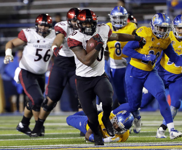 FILE - In a Saturday, Nov. 4, 2017 file photo, San Diego State running back Rashaad Penny runs against San Jose State during an NCAA college football game against San Jose State, in San Jose, Calif. Penny set a national season high with his 429 all-purpose yards against Nevada. He also became the first player since 1996 with two rushing touchdowns, one kick return touchdown and one punt return touchdown in the same game.(AP Photo/Marcio Jose Sanchez, File)