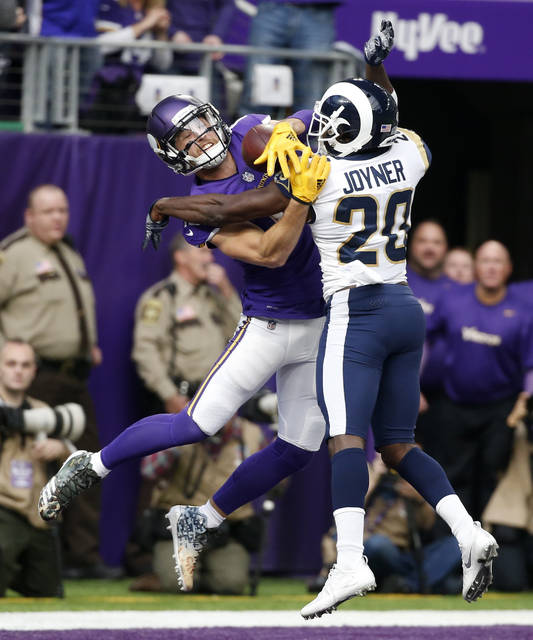 Los Angeles Rams free safety Lamarcus Joyner (20) breaks up a pass intended for Minnesota Vikings wide receiver Adam Thielen during the first half of an NFL football game, Sunday, Nov. 19, 2017, in Minneapolis. (AP Photo/Bruce Kluckhohn)