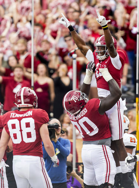 Alabama offensive lineman Alex Leatherwood (70) and wide receiver Cam Sims (17) celebrate a touchdown during the second half of an NCAA college football game against Mercer, Saturday, Nov. 18, 2017, at Bryant-Denny Stadium in Tuscaloosa, Ala. (Vasha Hunt/AL.com via AP)