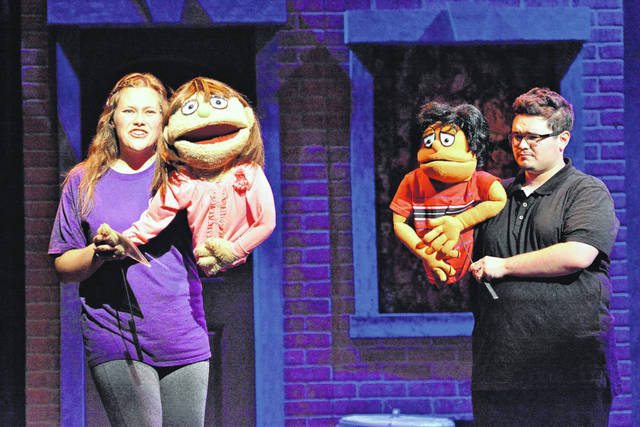 """Kate Monster (Jessica Fair) and Princeton (Joshua Woodward) make plans for a date in Wilmington College Theatre's presentation of the Tony Award-winning musical, """"Avenue Q,"""" which runs Thursday, Friday and Saturday at 7:30 p.m. in Heiland Theatre. Reservations can be made by contacting the Theatre Box Office weekdays, from 9 a.m. to noon and 1 to 4 p.m., at (937) 481-2267. This show is intended for mature audiences."""