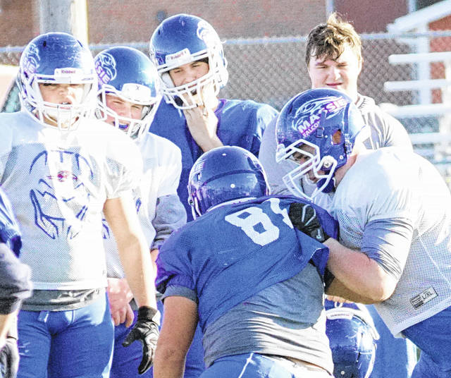 Several players look on during Tuesday's football practice as Clinton-Massie prepares for Wyoming. The two teams will play in the Div. IV Region 16 championship game 7:30 p.m. Friday at Lakota West High School.