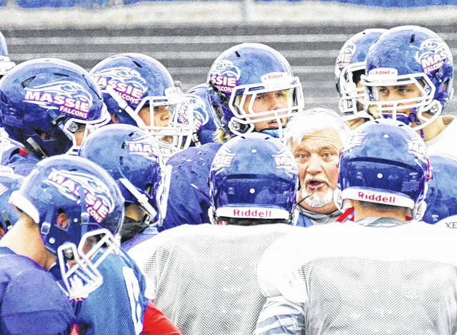 Clinton-Massie football coach Dan McSurley talks with his players prior to the start of team drills Monday at Frank M. Irelan Field. The Falcons will face No. 1 seed Valley View 7:30 p.m. Friday night at Beavercreek High School in the semifinal round of the Div. IV Region 16 playoff. For more photos of the Falcons at practice, see wnewsj.com.