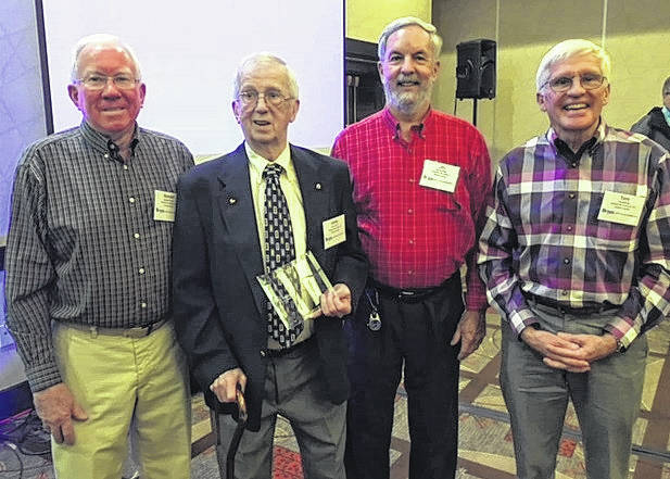 From left, Clinton County Habitat for Humanity volunteers and board members Wendell Compton, Lennis Perkins, Jim Krusling and Tom Matrka shared in the celebration of Perkins, who was named Volunteer of the Year, State of Ohio.