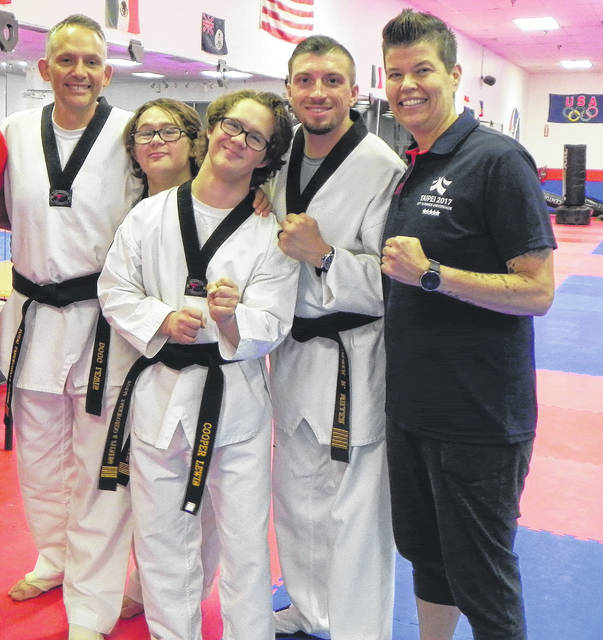 From left are Doug Lewis, Matthew Lewis, Cooper Lewis, Master Derek Miller and Master Christina Bayley, who owns Total Taekwondo & Fitness.