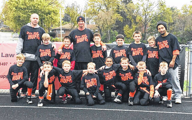 The third grade Wilmington Hurricane youth football team will face Springboro White 10:30 a.m. Saturday at Alumni Field in the semifinal round of the Western Ohio Junior Football Conference tournament. In the photo are players and coaches for the third grade Hurricane, from left to right, front row, Max McCoy, Jared Tackett, Isaac Newberry, Mason Scarberry, Josiah Puller, Connor Hornschmeier, AJ Kirk, Cooper Short; back row, coach James Kirk, Nickolas Clark, Matthew Manson, coach Todd Reynolds, Devin Cosby, Aiden Williams, Damian Simpson, Colton Knisley, coach Tino Keefer.