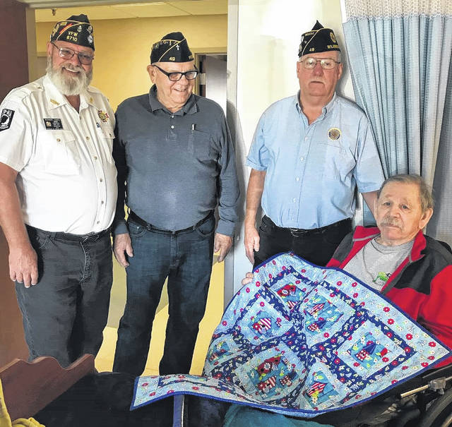 Three veterans from The Laurels of Blanchester recently received quilts to honor them for their service as Veterans Day neared. The quilts were made by the Clinton County Quilters and are given to area veterans to thank them and to commemorate them for their military service in World War ll, Korea, Vietnam, Iraq and Afghanistan. The quilts are presented by the American Legion and VFW groups. The quilt project has been an initiative for about three years and to date they have given out about 60 quilts. Presenting the quilts were Brady Stevens, Bob Baker and Richard James to recipients John Fenner, Francis Beatty and Donald Acuff.