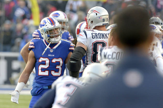 Buffalo Bills strong safety Micah Hyde (23) argues with New England Patriots tight end Rob Gronkowski (87) during the second half of an NFL football game, Sunday, Dec. 3, 2017, in Orchard Park, N.Y. (AP Photo/Adrian Kraus)