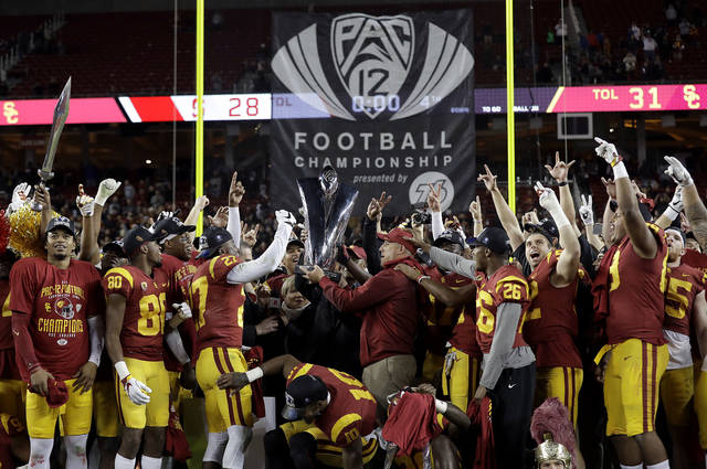 Southern California players and coaches celebrate after defeating Stanford 31-28 in the Pac-12 Conference championship NCAA college football game in Santa Clara, Calif., Friday, Dec. 1, 2017. (AP Photo/Marcio Jose Sanchez)