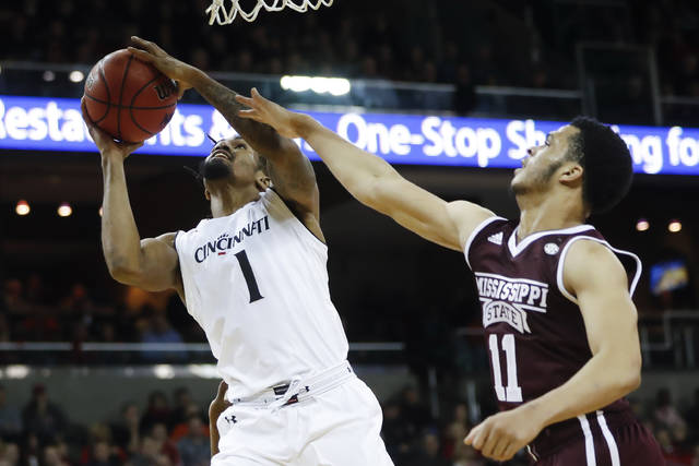 Cincinnati's Jacob Evans (1) shoots against Mississippi State's Quinndary Weatherspoon (11) in the second half of an NCAA college basketball game, Tuesday, Dec. 12, 2017, in Highland Heights, Ohio. Cincinnati won 65-50. (AP Photo/John Minchillo)