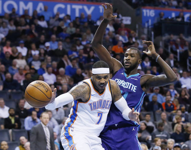 Oklahoma City Thunder forward Carmelo Anthony (7) loses the ball as he drives around Charlotte Hornets forward Michael Kidd-Gilchrist, right, in the third quarter of an NBA basketball game in Oklahoma City, Monday, Dec. 11, 2017. (AP Photo/Sue Ogrocki)
