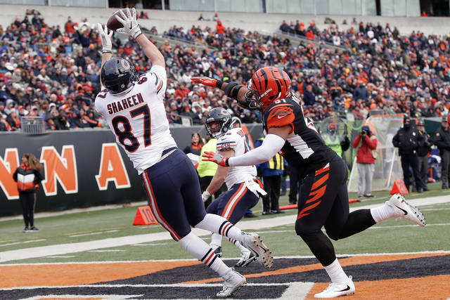 Chicago Bears tight end Adam Shaheen (87) catches a touchdown pass against Cincinnati Bengals middle linebacker Kevin Minter (51) in the second half of an NFL football game, Sunday, Dec. 10, 2017, in Cincinnati. (AP Photo/Gary Landers)