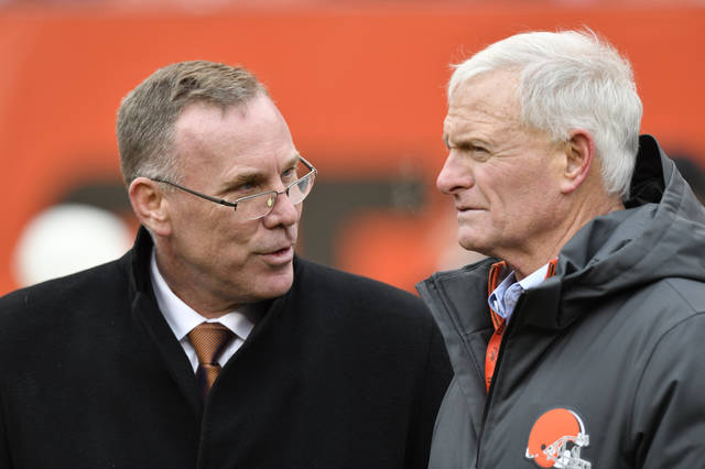 FILE - In this Sunday, Dec. 10, 2017 file photo, Cleveland Browns general manager John Dorsey, left, talks with owner Jimmy Haslam before an NFL football game against the Green Bay Packers in Cleveland. New Browns general manager John Dorsey played linebacker in the NFL. Turns out, he still hits hard. Dorsey, hired last week by owner Jimmy Haslam to fix his floundering franchise, harshly criticized the team's previous football head Sashi Brown on Thursday, Dec. 14, 2017 saying he failed to give coach Hue Jackson good players. (AP Photo/David Richard, File)