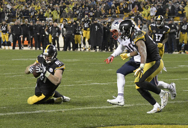 Pittsburgh Steelers tight end Jesse James (81) has a knee down before crossing the goal line with a pass from quarterback Ben Roethlisberger during the second half of an NFL football game against the New England Patriots in Pittsburgh, Sunday, Dec. 17, 2017. (AP Photo/Don Wright)