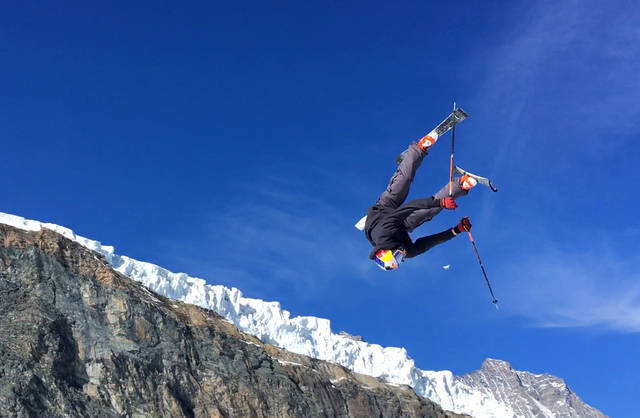 This photo taken from a 4K video and dated Wednesday, Oct. 18, 2017 shows a skier performing a jump during training on the glacier above Saas-Fee, Switzerland. The glacier attracted skiers and snowboard athletes from an array of nations, who came hunting for snow on which to train early in the season ahead of the 2018 Pyeongchang Olympics. (AP Photo/John Leicester)