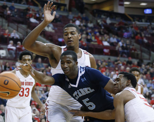 Citadel's Rob Johnson, center, loses control of the ball between Ohio State's Kaleb Wesson, left, and C.J. Jackson during the first half of an NCAA college basketball game Tuesday, Dec. 19, 2017, in Columbus, Ohio. (AP Photo/Jay LaPrete)