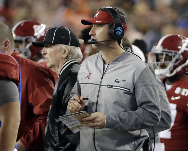 FILE - In this Jan. 9, 2017, file photo, Alabama offensive coordinator Steve Sarkisian is seen on the sidelines during the second half of the NCAA college football playoff championship game against Clemson, in Tampa, Fla. When Alabama switched offensive coordinators during last season's playoff, it had an in-house solution. The Crimson Tide's support staff included former Washington and Southern California head coach Steve Sarkisian, who took over the offense for the championship game.  Western Kentucky didn't have that luxury this season when offensive line coach Geoff Dart was diagnosed with brain tumors and underwent surgery to limit his availability. The Hilltoppers had to rely on tight ends coach Mike Mahaffey and graduate assistant Mike Bivin to pick up the slack.  Those two examples underscore the difference in staff sizes between Power Five programs and Group of Five schools.(AP Photo/David J. Phillip, File)