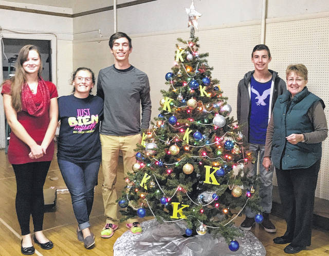 """The East Clinton High School Key Club decorated a tree for the """"Trees of Hope"""" fundraiser this month for Hope House, a drop-in emergency shelter for women in Wilmington. From left are East Clinton Key Club members Jazmin Carrico, Marah Dunn, Ethan Harrington, Clayton Harrington and East Clinton Key Club Advisor Jackie Walker. The Wilmington Kiwanis Club sponsors the youth group."""
