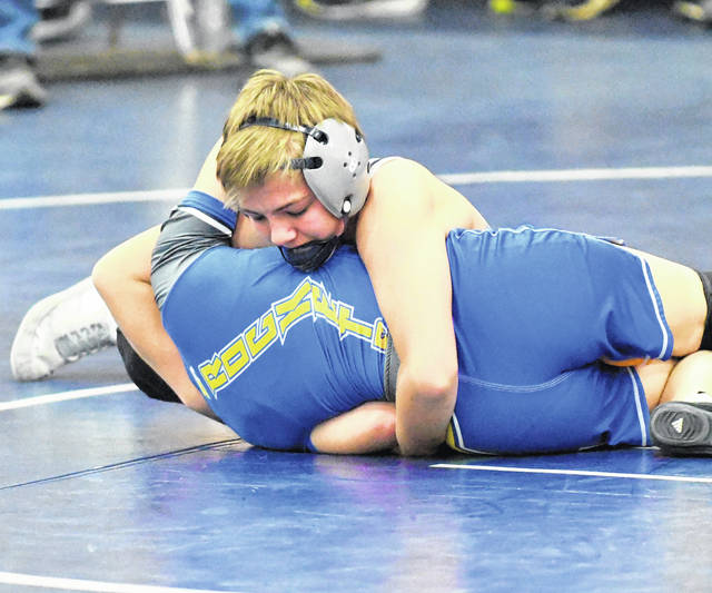 The second day of the Blanchester Holiday Duals wrestling tournament will begin 10:30 a.m. Saturday at the BHS gym. And what a beginning it should be. Unbeaten Blanchester will face unbeaten Clinton-Massie in the first match of the day. Both teams were 3-0 on Friday. Blanchester, Clinton-Massie, Batavia, Clermont Northeastern, London, New Richmond, Reading and Sycamore are the eight schools participating in the event. Admission price is $6 for adults, $4 for students and senior citizens. There are four matches for each school scheduled on Saturday. Blanchester defeated London 54-30, Clermont Northeastern 66-15 and New Richmond 49-26. Clinton-Massie was victorious over Sycamore 60-15, New Richmond 57-15 and Clermont Northeastern 65-18. In the photo, Blanchester's Cameron Gibson against Clermont Northeastern in a match at 113 pounds on Friday.