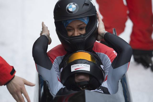 Canada's winners  Kaillie Humphries, front, and Phylicia George  celebrate after the women's bob competition at the Bob World Cup in Altenberg, Germany, Saturday, Jan. 6, 2018.  (Sebastian Kahnert/dpa via AP)
