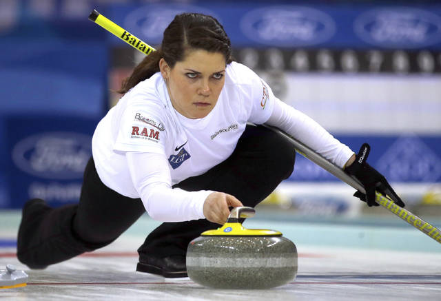 FILE - In this March 23, 2017, file photo, United States' Becca Hamilton releases the stone during a match against Switzerland in the Women's World Curling Championship in Beijing.  No one will work longer hours at the Pyeongchang Olympics than American curlers Matt and Becca Hamilton. By qualifying for both the new mixed doubles discipline and the traditional, single-gender curling event, the siblings from McFarland, Wisconsin, could be on the ice for as many as 50 hours _ by far the longest anyone will be in live competition at the Winter Games. (AP Photo/Mark Schiefelbein, File)