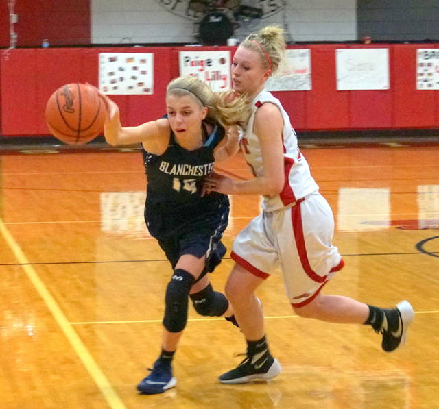 Blanchester's Olivia Gundler (left) and East Clinton's Paige Lilly (right) battle for the ball during Thursday's game at ECHS.