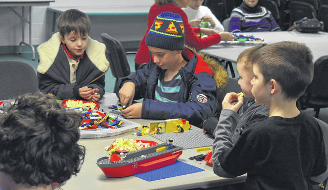 Lego building at the Wilmington Public Library's Lego Club is a great way to escape the cold Wednesday.