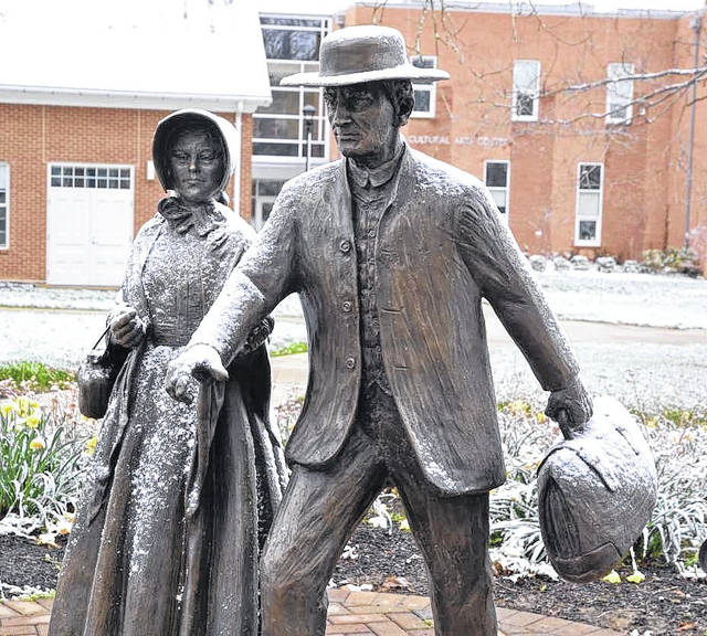 "Wilmington College's statue, titled ""Who Sends Thee?,"" depicts local Quakers Isaac and Sarah Harvey embarking upon their trip to promote the abolition of slavery in a meeting with President Lincoln."