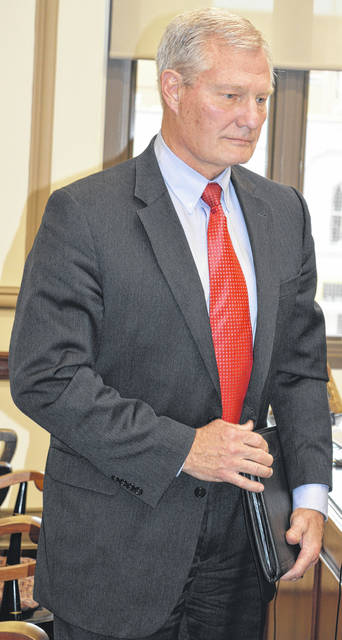Bill Bradish of Palmer Energy Company, which assists Clinton County with re-negotiating the local electric aggregation rate, meets Wednesday with the Clinton County commissioners.