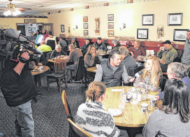 """Diners at Momma's West Main Cafe in Hillsboro enjoy breakfast and conversation as Fox host Pete Hegseth interviews local banker Diana Grooms during the """"Fox & Friends"""" visit Wednesday."""