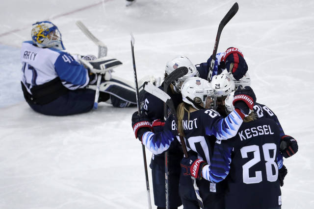 Players from the United States celebrate after Dani Cameranesi (24), of the United States, scores a goal against Finland during the third period of the semifinal round of the women's hockey game at the 2018 Winter Olympics in Gangneung, South Korea, Monday, Feb. 19, 2018. (AP Photo/Julio Cortez)