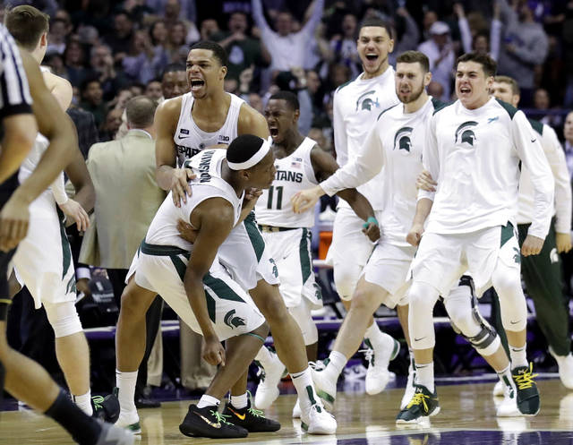Michigan State Michigan State guard Cassius Winston, left, celebrates with guard/forward Miles Bridges after scoring a basket during the second half of an NCAA college basketball game against Northwestern, Saturday, Feb. 17, 2018, in Rosemont, Ill. Michigan State won 65-60. (AP Photo/Nam Y. Huh)