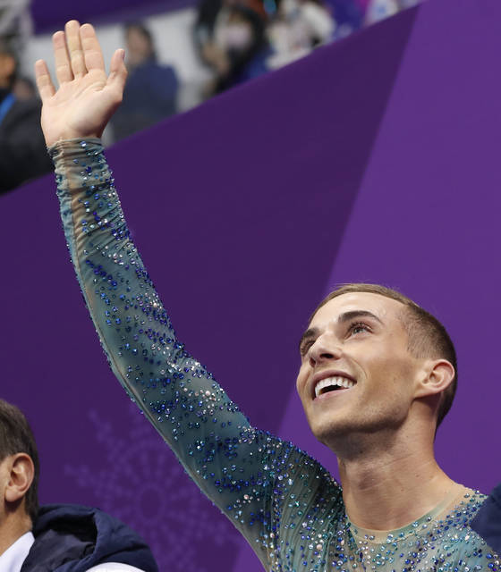Adam Rippon of the United States reacts as his score is posted following his performance in the men's free figure skating final in the Gangneung Ice Arena at the 2018 Winter Olympics in Gangneung, South Korea, Saturday, Feb. 17, 2018. (AP Photo/Bernat Armangue)