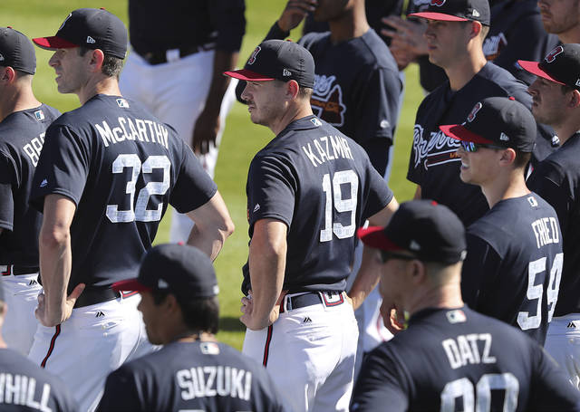 Atlanta Braves pitchers Brandon McCarthy (from left), Scott Kazmir, and Max Fried take the field to start another day of spring training on Sunday, Feb 18, 2018, at the ESPN Wide World of Sports Complex in Lake Buena Vista, Fla. (Curtis Compton/Atlanta Journal-Constitution via AP)