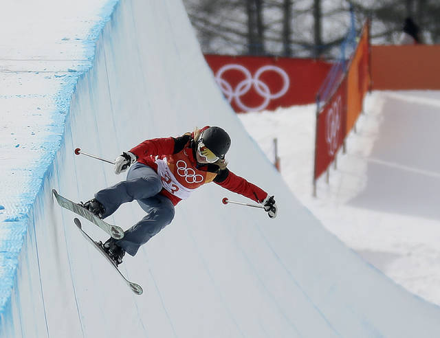 Elizabeth Marian Swaney, of Hungary, runs the course during the women's halfpipe qualifying at Phoenix Snow Park at the 2018 Winter Olympics in Pyeongchang, South Korea, Monday, Feb. 19, 2018. (AP Photo/Kin Cheung)