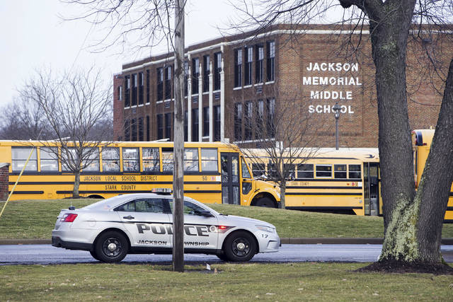 A police car is parked outside Jackson Township Middle School, Tuesday, Feb. 20, 2018 in Massillon, Ohio. A school official in Ohio says a middle school student apparently shot himself after bringing a gun to school. Police say Jackson Middle School, near Massillon, is on lockdown Tuesday and that the students and staff are safe.(Bob Rossiter/The Canton Repository via AP)