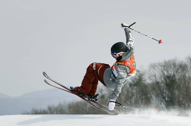 FILE - In this Feb. 18, 2018, file photo, GusKenworthy, of the United States, jumps during the men's slopestyle final at Phoenix Snow Park at the 2018 Winter Olympics in Pyeongchang, South Korea. Gay athletes have made their presence felt like never before in Pyeongchang, from feuding with Vice President Mike Pence to openly displaying their affection with a simple kiss. (AP Photo/Kin Cheung, File)
