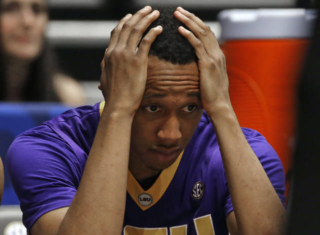 FILE - In this March 12, 2016, file photo, LSU's Tim Quarterman watches the final moments of the second half of an NCAA college basketball game against Texas A&M in the Southeastern Conference tournament in Nashville, Tenn. Bank records and other expense reports that are part of a federal probe into college basketball list a wide range of impermissible payments from agents to at least two dozen players or their relatives, according to documents obtained by Yahoo Sports. A balance sheet said Tim Quarterman, now playing for the Agua Caliente Clippers of the NBA G League, received at least $16,000 while a junior at LSU. (AP Photo/John Bazemore, File)