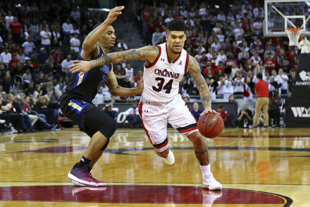 Tulsa's DaQuan Jeffries defends against Cincinnati Jarron Cumberland during the first half of an NCAA college basketball game, Sunday, Feb. 25, 2018, in Highland Heights, Ky. (AP Photo/Aaron Doster)
