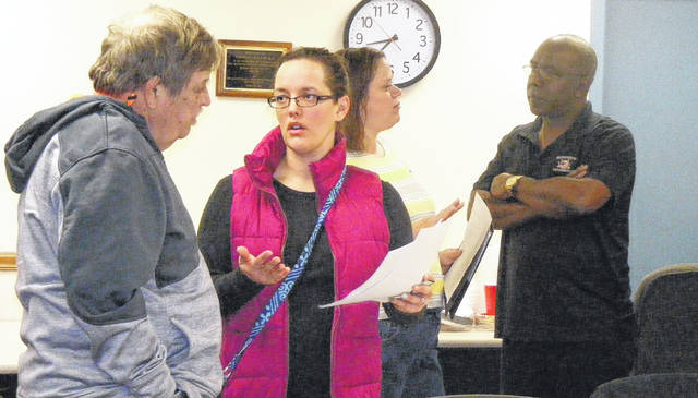 After a Saturday work session of the school board on grade-level centers, a couple residents approached board members with their concerns. From left are board member Steve Murphy, parent Christy Snook, an unidentified resident, and Board President Marty Beaugard.