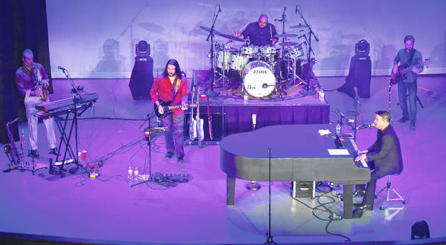 The Stranger — a Billy Joel tribute act from North Carolina — entertains their Murphy Theatre audience during their show on Saturday.