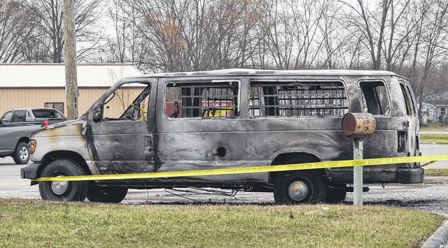 The remains of a van that burned in front of Midland Tire early Wednesday morning.