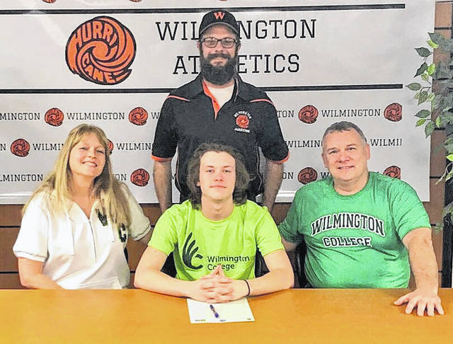 """Wilmington High School senior Blake Frazier has decided to continue his lacrosse career at Wilmington College. """"I am excited to see Blake have the opportunity to play lacrosse at the next level at Wilmington College. He has earned this through developing his skills during the off-season, becoming a better teammate my being a multi-sport athlete and excelling in the classroom,"""" Wilmington High School head coach Adam Shultz said. In the photo, from left to right, mother Sandy Frazier, Blake Frazier, Mike Frazier; back row, coach Adam Shultz."""