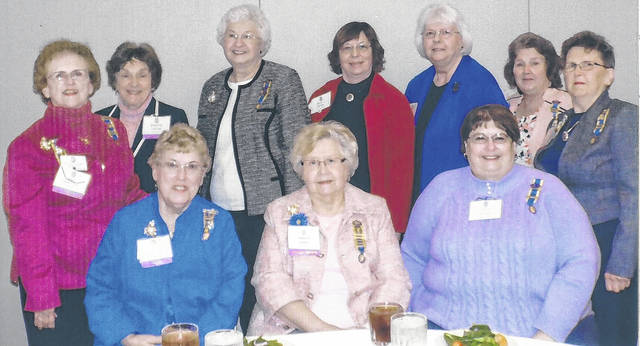 """The daughters in the photo attended the Fifty-Eighth State Conference of the Ohio Society Colonial Dames XVII Century at the Columbus Marriott Northwest in Dublin, Ohio on Feb. 23-24. They heard about Abraham Lincoln from Eric Ebinger. Also there were many reports on the state of the society. The convention was closed by singing """"God Bless America."""" Shown are: front, Nancy Bernard, Frances Sharp, and Leslie Holmes and, back, Pat McKenzie, Martha Saylor, Joyce Peters, Susan Henry, Linda Lee, Kay McIntire, and Karen McKenzie."""