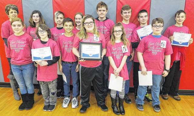 The 12 school finalists, plus an alternate and a Gifted Intervention Specialist pose for this photo from the East Clinton Middle School's Spelling Bee competition. From left in the front row are Josie Runk, John Orchard, Kaleb Bauman, McKayla Long, Eleina Tillman and Austin Hodson; and from left in the back row are Gifted Intervention Specialist Regina Gerber, Paige Fetters, Jon Fast, alternate Katie Carey, Teddy Murphy, Van Frye, Lex Frye and Jayden Brown.
