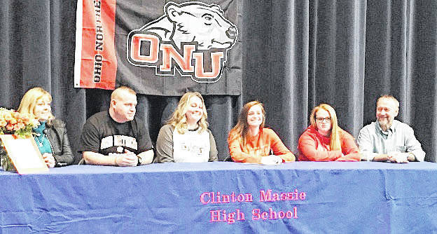 Clinton-Massie senior Mikhayla Carter has chosen Ohio Northern University to continue her soccer career. In the photo, from left to right, grandmother Becky Conard, father Shane Carter, mother Amber Carter, Mikhayla Carter, sister McKenzie Carter, and grandfather Jeff Conard.