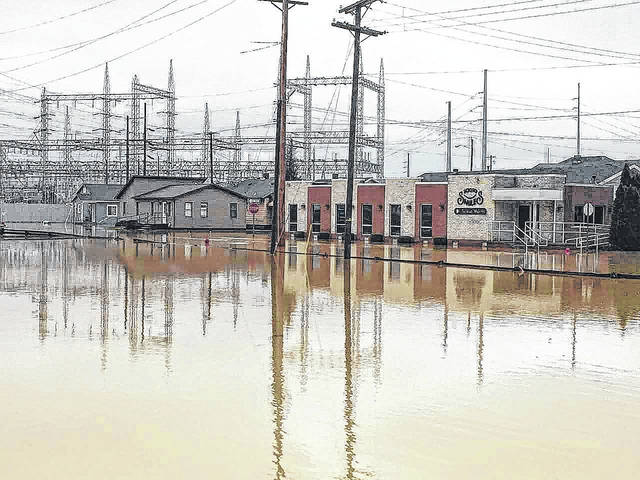 Areas in the block between eastbound U.S. 52 and westbound U.S. 52 were underwater Thursday as flooding spread across New Boston, Ohio, near Portsmouth along the Ohio River.
