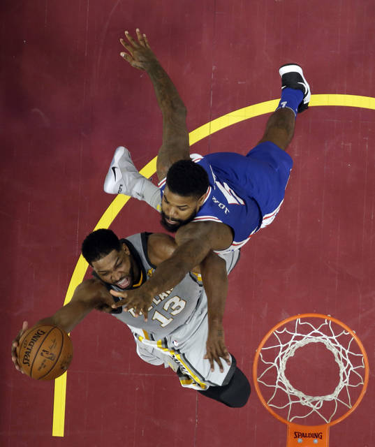 Cleveland Cavaliers' Tristan Thompson, left, drives to the basket against Philadelphia 76ers' Amir Johnson in the first half of an NBA basketball game, Thursday, March 1, 2018, in Cleveland. (AP Photo/Tony Dejak)
