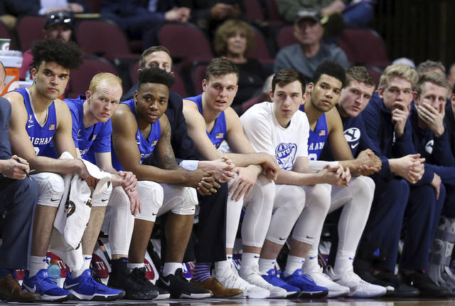 The BYU bench watches during the final minutes of the second half of the West Coast Conference tournament championship NCAA college basketball game against Gonzaga Tuesday, March 6, 2018, in Las Vegas. Gonzaga defeated BYU 74-54. (AP Photo/Isaac Brekken)