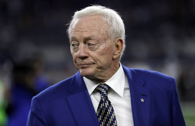 FILE - In this Nov. 19, 2017, file photo, Dallas Cowboys team owner Jerry Jones stands on the field during warm ups before an NFL football game against the Philadelphia Eagles in Arlington, Texas. Jones has agreed on Wednesday, March 7, 2018, to pay the NFL more than $2 million in legal fees resulting from two disputes the Dallas Cowboys owner had with the league, a person with direct knowledge of the settlement tells The Associated Press.(AP Photo/Ron Jenkins, File)
