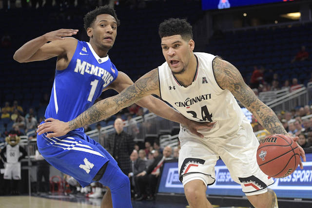 Cincinnati guard Jarron Cumberland (34) drives to the basket in front of Memphis guard Jamal Johnson (1) during the first half of an NCAA college basketball game in the semifinals at the American Athletic Conference tournament Saturday, March 10, 2018, in Orlando, Fla.(AP Photo/Phelan M. Ebenhack)